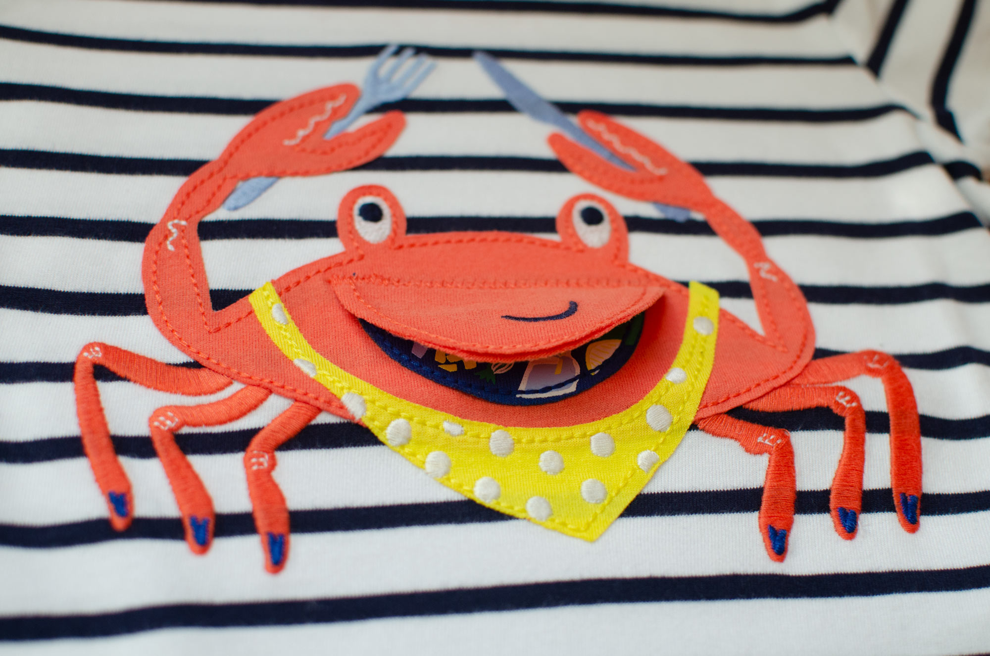 Crab chomp applique designed by Elly Jahnz for Joules Clothing