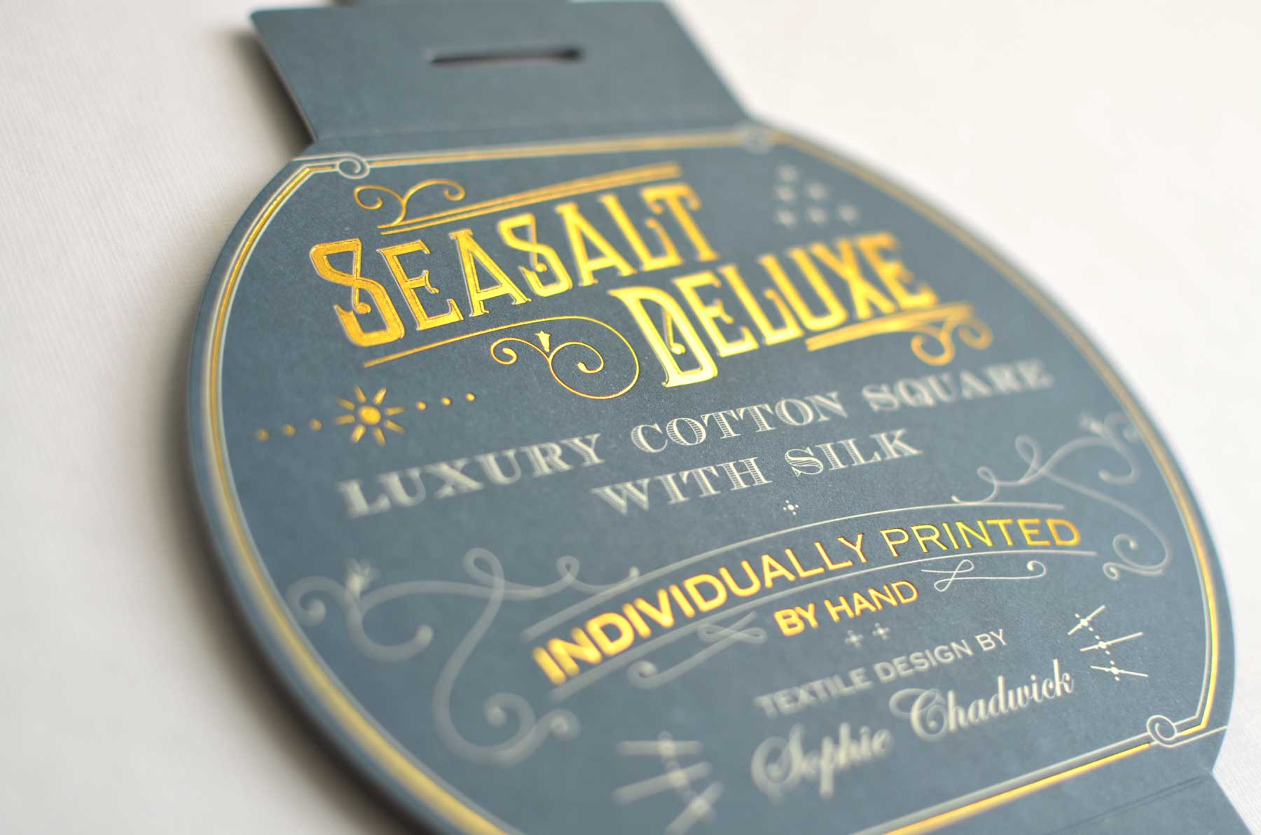 Packaging for cotton and silk scarf. Gold foil, uncoated card. For Seasalt Cornwall.
